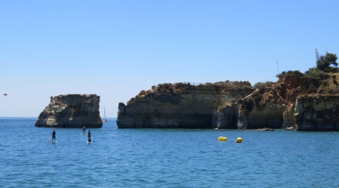 Stand-up paddle-boarding on the water in Lagos, Algarve, Portugal